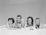Family Lying on Beach, Laughing Photographic Print by H. Armstrong Roberts