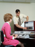 Man Helping Woman With Data Entry Computer Photographic Print by H. Armstrong Roberts