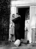 Sailor With Duffel Bags, Hugging Woman, About To Kiss on Front Doorstep Photographic Print by H. Armstrong Roberts