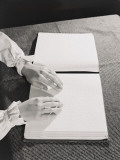 Woman&#39;s Hands Reading Braille Book on Table Photographic Print by H. Armstrong Roberts