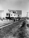 Group of Men Moving House on Wheels Across Railroad Tracks Photographic Print by H. Armstrong Roberts