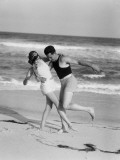 A Couple in 1920's Bathing Costumes Frolic on a Beach, Circa 1965 Photographic Print by H. Armstrong Roberts