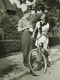 Young Couple Talking on Street, Woman on Bicycle Photographie par George Marks