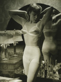 Young Woman in Underwear Standing By Mirror Photographic Print by George Marks