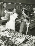 Mother and Daughter in Supermarket, Shop Assistant Weighing Groceries Photographic Print by George Marks
