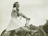 Young Woman Riding on Bicycle With Outstretched Legs Photographic Print by George Marks