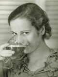 Young Woman Drinking Glass of Beer, Portrait Photographic Print by George Marks