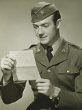 World War II Army Solider Reading Letter in Studio, Portrait Photographic Print by George Marks