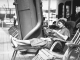 Woman Reading Magazine on Cruiser Deck Photographic Print by George Marks