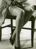 Woman With Silk Stockings Fixes Garter Photographic Print by George Marks