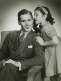 Daughter (8-9) Whispering Into Father's Ear Photographic Print by George Marks