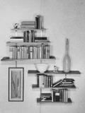 Books and Ceramics on Hanging Wall Shelves Photographic Print by George Marks