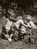 Little Boy and Girl Playing With Bicycle Photographic Print by George Marks