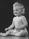 Crying Baby (12-18 Months) in Diaper Sitting on Floor in Studio, Photographic Print by George Marks