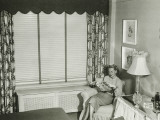 Woman Sitting on Armchair in Bedroom, Reading Fashion Magazine Photographic Print by George Marks