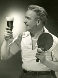 Man With Glass of Beer and Ping-Pong Paddle Fotografisk tryk af George Marks