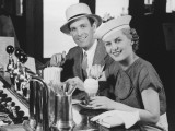 Man and Woman in Fancy Hat Drinking Ice Cream Soda Reproduction photographique par George Marks
