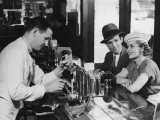 Bartender Pouring Beer For Young Couple in Bar Impressão fotográfica por George Marks
