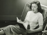 Woman With Bottle of Beverage, Reading Book Photographic Print by George Marks