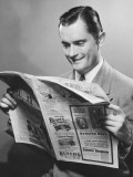 Young Businessman Reading Newspaper, Close-Up Photographic Print by George Marks