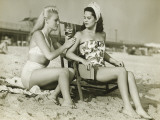 Two Women on Beach Applying Suntan Lotion Photographic Print by George Marks