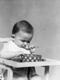 Baby Eating Photographic Print by H. Armstrong Roberts