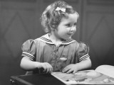 Young Girl (4-5) at Table Reading Book Photographic Print by George Marks
