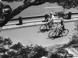 Elevated View of Man and Boy (12-13) Cycling Photographic Print by George Marks