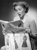 Woman Reading Newspaper With Look of Surprise Photographic Print by George Marks