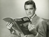 Elegant Young Man Reading Magazine in Studio Photographic Print by George Marks