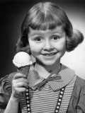 Portrait of Young Girl With Ice Cream Cone Photographic Print by George Marks