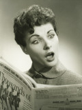 Shocked Woman Reading Newspaper in Studio, Portrait Photographic Print by George Marks