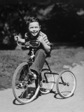 Young Boy (6-7) Riding Tricycle in Park, Portrait Photographic Print by George Marks