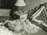 Woman Lying on Bed With Legs on Backrest, Elevated View Photographic Print by George Marks