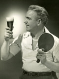 Man With Glass of Beer and Ping-Pong Paddle Reproduction photographique par George Marks