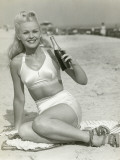 Young Woman Sitting on Beach With Soft Drink, Portrait Papier Photo par George Marks