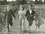 Two Couples Holding Hands, Running on Footpath Photographic Print by George Marks