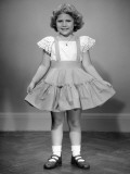 Little Girl Holding Her Ruffled Skirt Out Photographic Print by George Marks