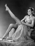 Woman in Evening Wear Pullin on Silk Stockings Photographic Print by George Marks