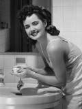 Young Woman Washing Hands in Bathroom, Portrait Photographic Print by George Marks
