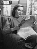 Young Woman Sitting in Armchair, Reading Newspaper Photographic Print by George Marks