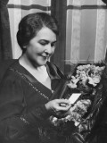 Woman Holding Bouquet, Reading Note Photographic Print by George Marks