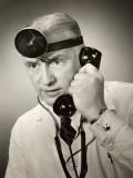 Portrait of a Doctor on the Telephone Photographic Print by George Marks