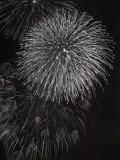 Fireworks Exploding in Sky at Night Photographic Print by George Marks