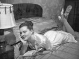 Woman in Silk Night Gown Reading on Bed Photographic Print by George Marks