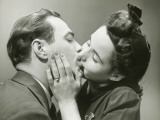 Young Couple Kissing, Close-Up, Studio Shot Photographic Print by George Marks