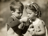 Boy Gives Ice Cream To Sister Photographic Print by George Marks