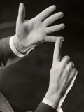 Businessman Making Point With Hands Photographie par George Marks