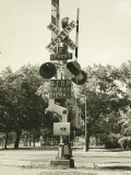 Railroad Crossing Sign and Warning Light Photographic Print by George Marks