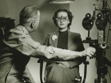 Optician Examining Patient's Eyes Photographic Print by George Marks